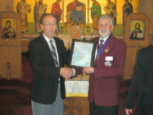 KOFC 4949: Brother Victor Szadak received his Lifemember from GK Guenter . Rieger