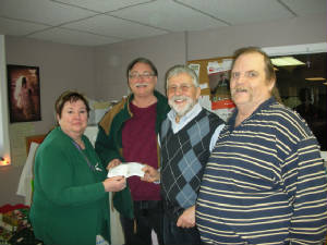 "KOFC 4949: GK Guenter A. Rieger presents a check of $500 on behalf of Council 4949 to the ""Together for Christmas"" team. Click on picture to watch video"