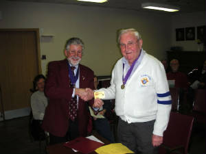 KOFC 4949 Deputy Grand Knight Sir Pat Hagel receives from Grand Knight Guenter Rieger  the new (gold) Life Member card. Pat Hagel belomngs to the Knights for over 60 Years.