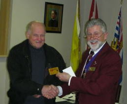 KOFC4949 Martin Belec received from Grand Knight Guenter A. Rieger his certificate Golden Life Membership card